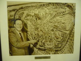 Photo of   Walt Disney showing off the park