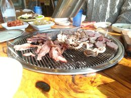 Both roasted duck and smoked duck being grilled at the table over wood coals. Potatoes were roasting with the coals. The side dishes of various types of kimchee and sauces were superlative! , Alan - March 2015