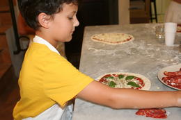 Nico putting the finishing touches on his pizza. , leesac143 - July 2014