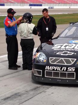 Me getting suited up for my ride in a real Nascar, Krystal W - March 2014