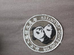 Photo of Chengdu Viator Exclusive: Volunteer at Panda Breeding Center with Optional Panda Holding the logo/awesome gear you get to wear