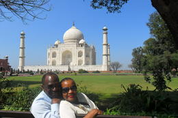 Photo of   David and Jackie taking a breather after touring the Taj Mahal