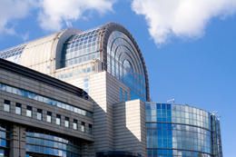 Side view of the stylish glass-covered European Parliament building in Brussels - June 2011