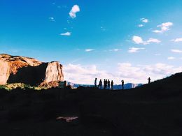 Some of our group from a distance at one of the stops on the Monument Valley Jeep tour. , katiefittler - July 2015