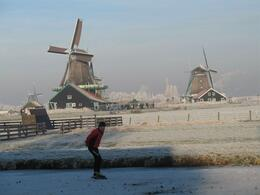 Photo of Amsterdam Zaanse Schans Windmills, Marken and Volendam Half-Day Trip from Amsterdam Skaters at Zaanse Schans Windmill