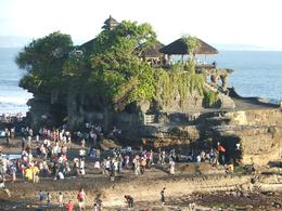 This photo is looking down onto Tanah Lot. You are not allowed to go up onto the temple, but only to walk around the outside. It was about half an hour before sunset., Gail F - July 2009