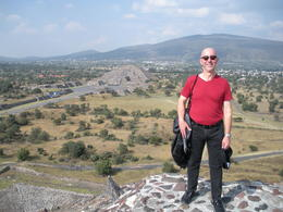 Me at the top of the Pyramid of the Sun, with the Pyramid of the Moon in the background , Alberto L - November 2014