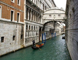 The Bridge of Sighs has windows with stone bars. It passes over the Rio di Palazzo and connects the old prisons to the interrogation rooms in the Doge's Palace. - May 2011