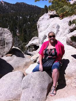 Photo of Palm Springs Palm Springs Aerial Tramway me with a massive drop behind me after that rock