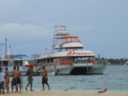 Photo of Cancun Sightseeing, Snorkeling and Dancing Catamaran Cruise from Cancun Dancers docked at Isla Mujeres.