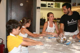 Here are some of the children in the class getting help from our instructor as we began to make our dough. , leesac143 - July 2014