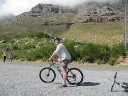 Me on bike with Table Mountain behind. - February 2010