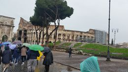 Photo of Rome Skip the Line: Ancient Rome and Colosseum Half-Day Walking Tour walking in the rain