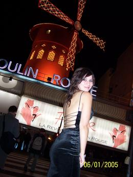 This is me in front of the Moulin Rouge after the dinner and show. I decided to dress to the nines and make a night of it. I'm smiling because the show was entertaining and the people I met on the ... , Jasmine G - January 2008