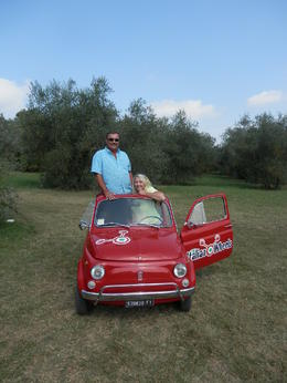 Photo of Florence Self-Drive Vintage Fiat 500 Tour from Florence: Tuscan Hills and Italian Cuisine This was a stop overlooking an olive grove and grapevines.  Beautiful view!