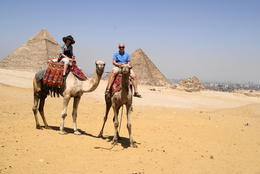 My wife and I on the camels at the Pyramids , John g K - May 2011