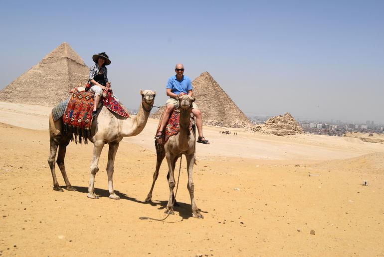 My wife and I on the camels at the Pyramids