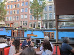 Photo of Amsterdam Amsterdam Canals Pizza Cruise Passing the ubquitous house boats
