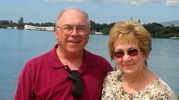 We are waiting to ride the shuttle boat out to the Arizona Memorial which is in background of photo. , Cheryl H - May 2015