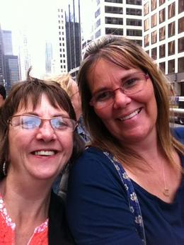 Kim and Kelly in downtown Chicago, on top of a bus during rush hour Friday night traffic. Amazing. , Kim R - August 2014