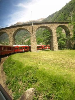The Bernina Express making its way up the viaduct at Bruscio. Sit on the left side in the last coach for the best shot., AI S - June 2010