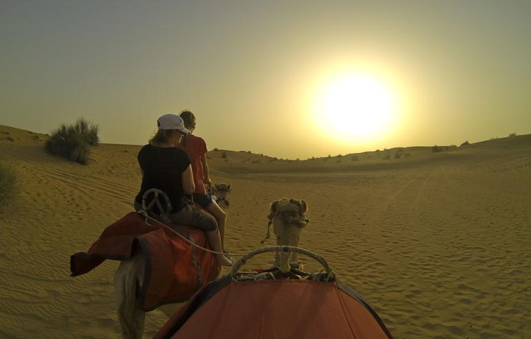 camel ride into the sun - Dubai