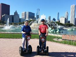 A photo of Rob Runyard and Sue Ericson-Runyard, enjoying themselves during their Segway tour, on their 20th wedding anniversary, in front of beautiful Buckingham Fountain. , Robert R - October 2013