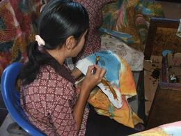 Batik is a traditional form of painting fabric. They painstakingly use dots and lines from wax to decorate the cloth. It is very impressive to watch., Gail F - July 2009