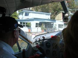 A view I have never seen before. The plane about to tie up to the jetty along side some boats at the Cottage Point restaurant. The pilot and co-pilot Janice in the front seats., Colin D - April 2008