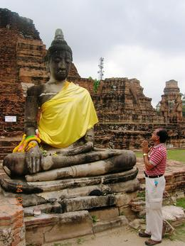 In the ruins of Wat Maha That which is over 600 years old, a holy relic of Lord Buddha where I am offering prayer. , TARA NATH R - May 2011