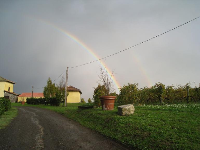 After the rain cleared... what a rainbow. - Rome