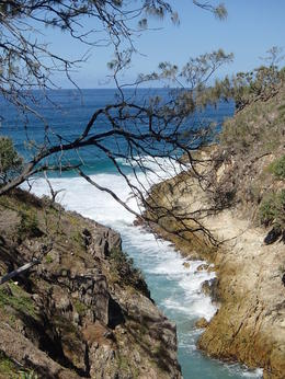 Photo of Brisbane Stradbroke Island Day Trip from Brisbane Blue water and steep clifs