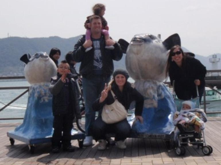 Great pic with the family and the giant pufferfish! - Osaka