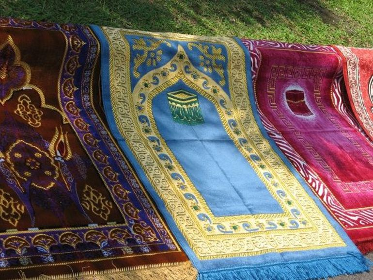 These colorful rugs were for sale at the Mosque on the tour. The mosque is beautiful and allows for a view of Singapore across the water.