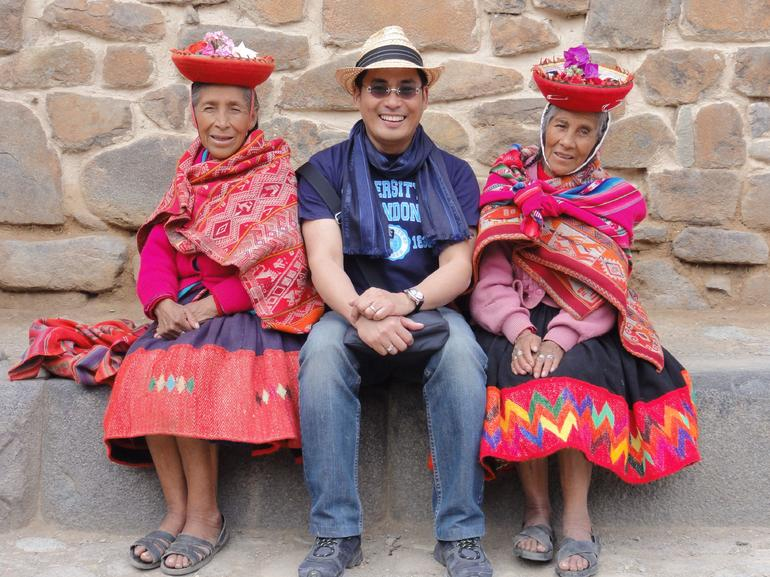 Posing with Peruvian women in traditional dress.