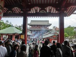 View from Asakusa Kannon to the crowded Nakamise shopping street. Cleansing incense in the middle. In the shopping street, be sure to pick up a baked apple pastry and green tea/ vanilla swirl ice ... , ginalee912 - May 2016