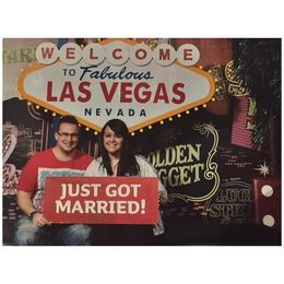 Photo before going into Madame Tussauds - We didnt actually get married but thought it would be fun to trick people at home, haha! When in Vegas.. , Amy L - February 2015