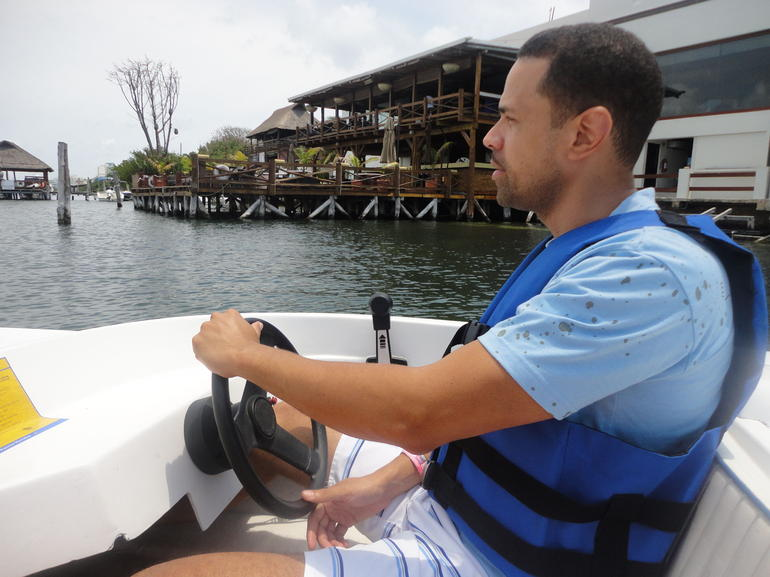driving the boat - Cancun