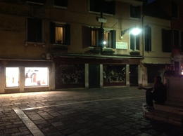 Piazza by night. Young Italian on a mobile phone , nettee - September 2012
