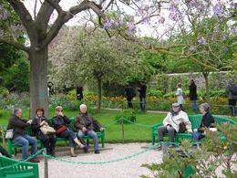 Tourists enjoying a rest in the gardens at Giverny - May 2010
