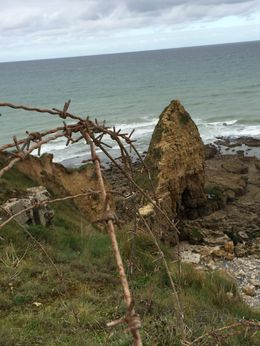 Battered by bombs and penetrated by courageous US Army Rangers, the German bunker above the cliffs at Pointe du Hoc lay open now to tourists. The invasion clearly was hell for all involved. , Frank R - October 2015