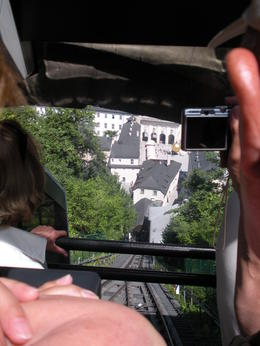 Looking down at the tracks and city of Salzburg while riding up the mountain to the castle , Thomas E - June 2011