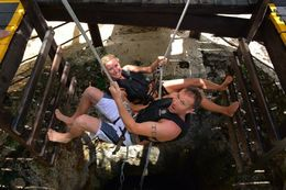 My husband and I repelling into the Cenote. , Michelle M - June 2016