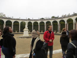 Photo of Paris Skip the Line: Versailles Palace and Gardens Day Trip from Paris by Train Tour guide explaining