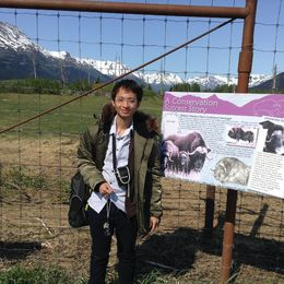 Ekkapong enjoyed watching the elk in the field , eak_dent_cu - June 2015
