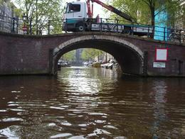 Photo taken at the intersection of Prinsengracht and Reguliersgracht. This was a nice change of pace... to sit in a boat for an hour and let the city come to us. I got a map from the hotel (we stayed ... , Cara Rose R - April 2009