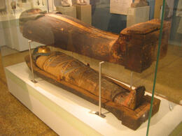 Photo of   National Archaeological Museum, Wooden Sarcophagus with the Mummy of Hapi, son of Pami, with Gilt Mask