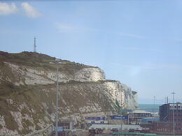 "The white cliffs of Dover as seen from the ground next to the English Channel ""beach."" Not the best view, but there's no road that goes around the cliffs. , Jessica - July 2011"