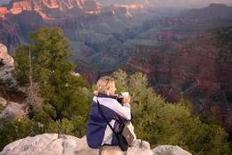 Taking a moment to reflect on the rim of the Grand Canyon, Rachel - October 2012
