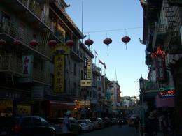 Photo of   Neon signs & hanging lanterns, San Francisco's Chinatown at dusk